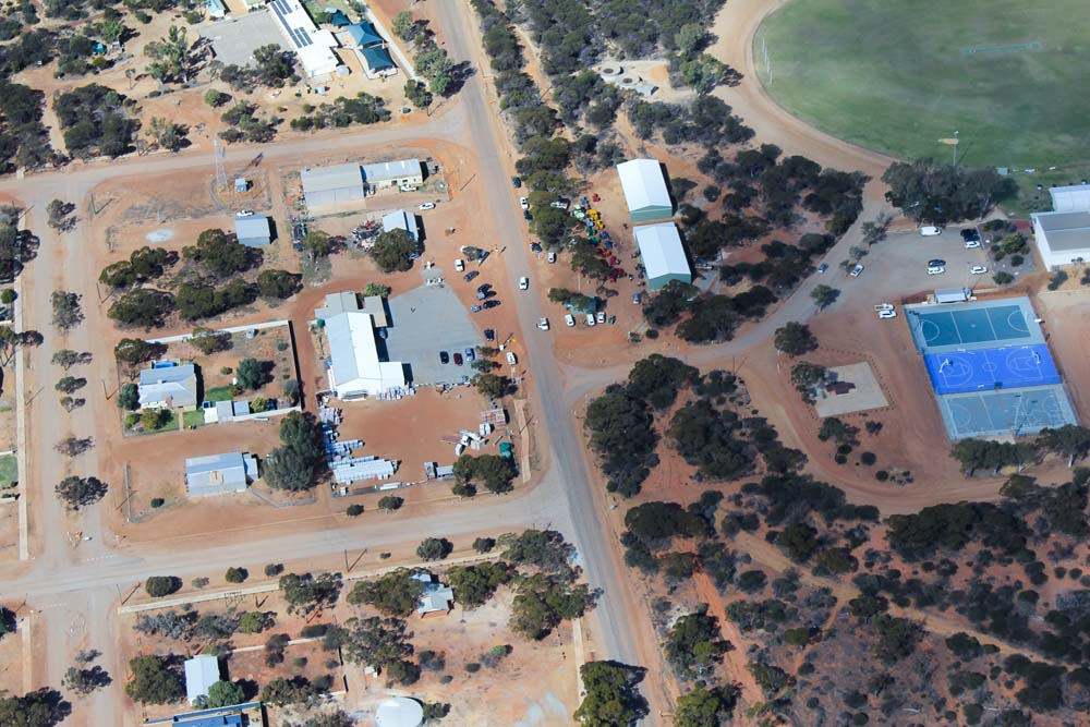 aerial view of Beacon town site showing school, sporting grounds and complex, central stores and houses