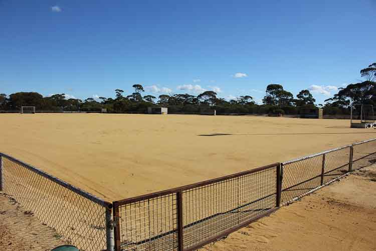 photo of Beacon Hockey Oval taken from corner with fence